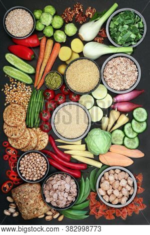 Vegan food for health and fitness with foods high in protein, vitamins, minerals, anthocyanins, omega 3, antioxidants, smart carbs and dietary fibre. Healthy ethical eating concept. Flat lay.