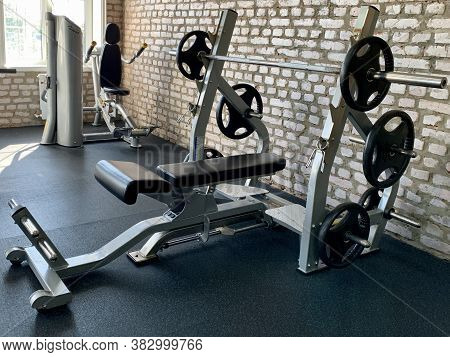 Gym For Bodybuilding. Heavy Dumbbells And Exercise Equipment. Barbells And Equipment For Athletes. I