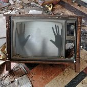 Ghost emerges through broken flickering television screen in haunted house. poster