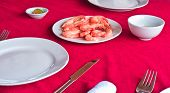 Fresh delicious prawns served on white plate in vietnamese restaurant poster