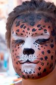 cute girl kid face with painted panther color mask ** Note: Slight blurriness, best at smaller sizes poster