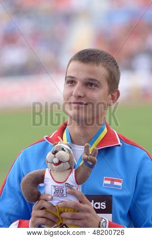 DONETSK, UKRAINE - JULY 13: Matija Greguric of Croatia win gold medal in hammer throw during 8th IAAF World Youth Championships in Donetsk, Ukraine on July 13, 2013