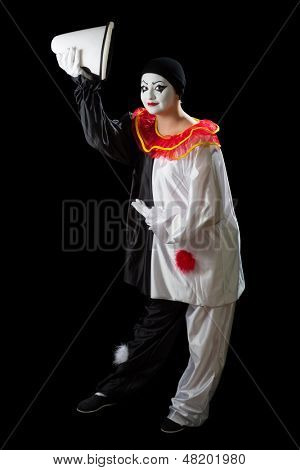 Mime Pierrot isolated on black greeting with her hat