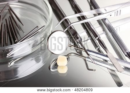 Set of dental tools for teeth care isolated on grey background