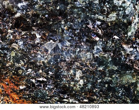 Rock With Crystal And Metallic Inclusions