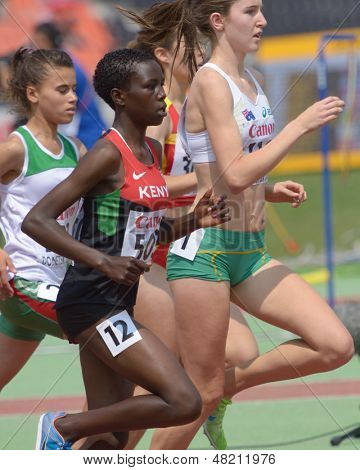 DONETSK, UKRAINE - JULY 12: Chepngetich, Kenya, McCormick, Australia (right), Yahi, Algeria (left) compete in steeplechase during IAAF World Youth Championships in Donetsk, Ukraine on July 12, 2013