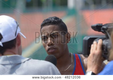 DONETSK, UKRAINE - JULY 12: Reynier Mena of Cuba win the heat in 200 metres during 8th IAAF World Youth Championships in Donetsk, Ukraine on July 12, 2013