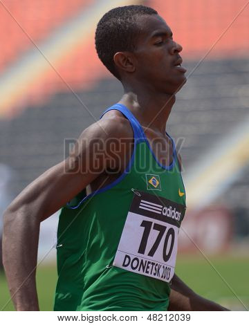 DONETSK, UKRAINE - JULY 12: Vitor Hugo dos Santos of Brazil win the heat in 200 metres during 8th IAAF World Youth Championships in Donetsk, Ukraine on July 12, 2013