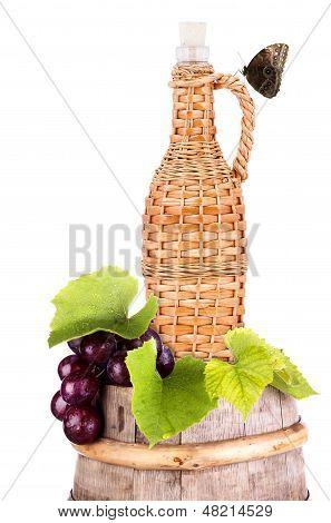 grapes on a wooden vintage barrel background