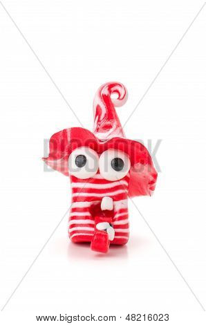 Handmade modeling clay figure with red and white stripes