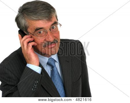 Senior Businessman On Cellphone