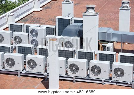 view on the roof of a building of a large air conditioning equipment poster
