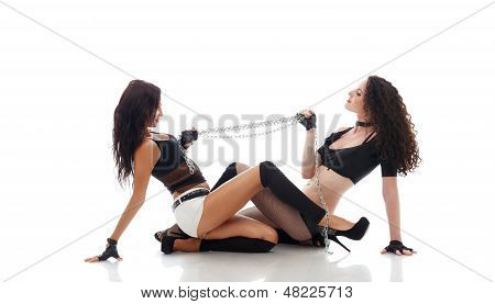 Image of two sexy babes posing dragging chain