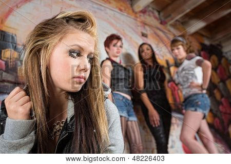 Mean Group Near Sad Girl