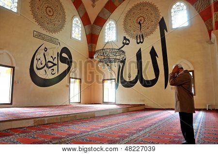 Muslim prayers in the mosque alone