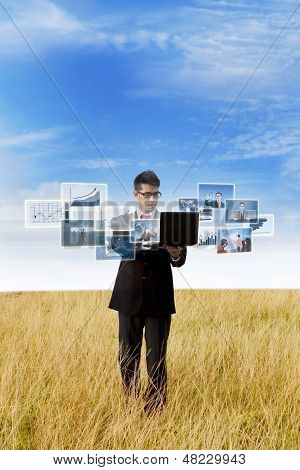 Businessman Looking At Online Photos Outdoor