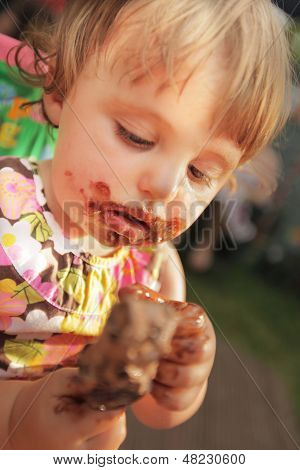 Little girl devouring first ice cream