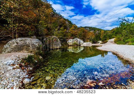 A Picturesque Nature Scene with Beautiful Fall Foliage on a Tranquil Babbling Brook