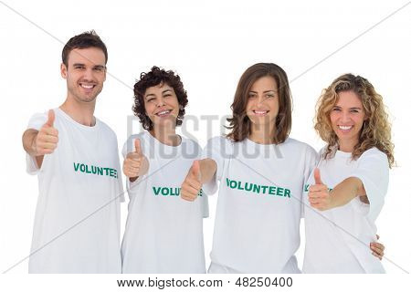 Cheerful group of volunteers giving thumbs up on white background