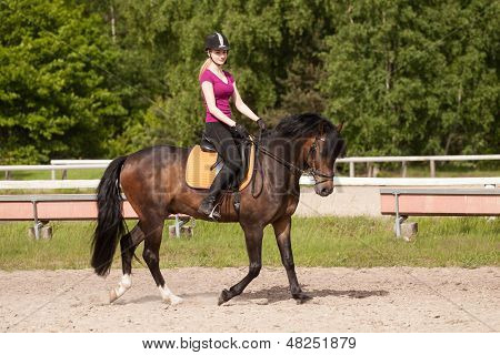 Girl Rides Her Horse