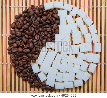 The composition of the coffee and sugar in the form of yin and yang poster