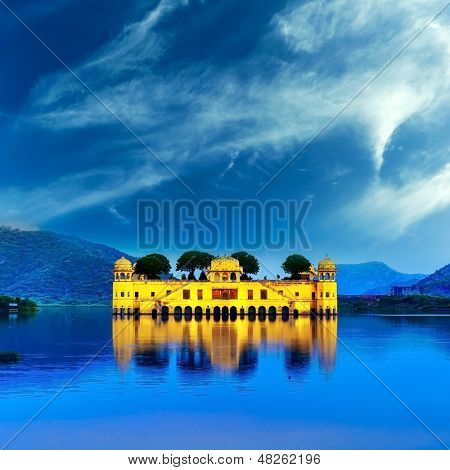 Indian water palace on Jal Mahal lake at night time in Jaipur, India
