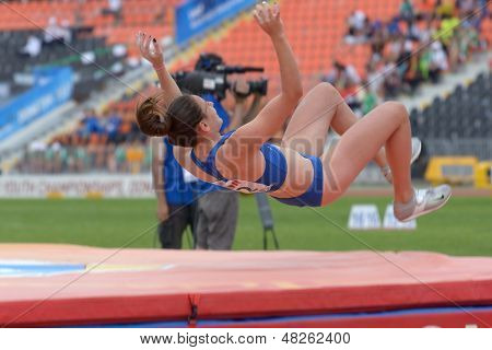 DONETSK, UKRAINE - JULY 11: Kseniya Novikova of Russia competes in pole vault during 8th IAAF World Youth Championships in Donetsk, Ukraine on July 11, 2013