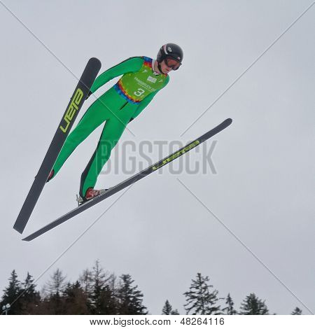 SEEFELD, AUSTRIA - JANUARY 19 Michal Pytel (Poland) jumps in Seefeld during a training session on January 19, 2012 in Seefeld, Austria.