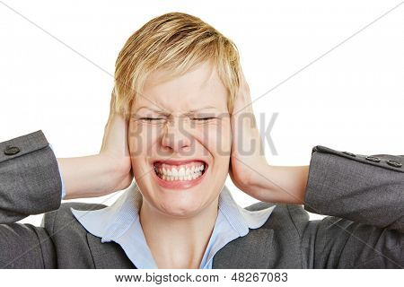 Angry young business woman making a grimace with her ears closed