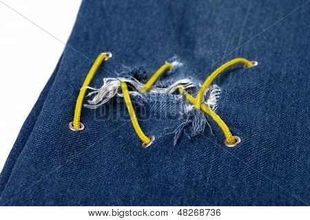Blue Jean With Hole And Crisscross Yellow Lacing