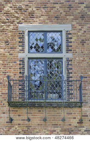 Tudor Style Windows With Balcony