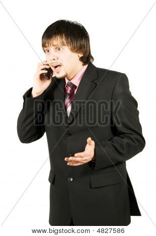 Frustrated Businessman Calling On The Cellular Phone