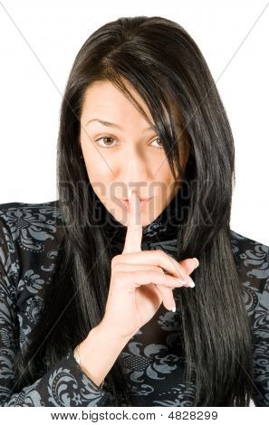 Shh. Secret - Young Beautiful Woman With Finger Over Her Mouth