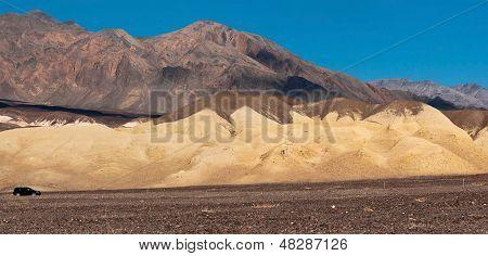 Small Car In A Big Desert