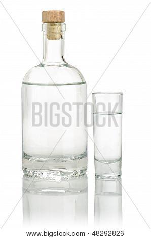 Liquor bottle with a full shot glass