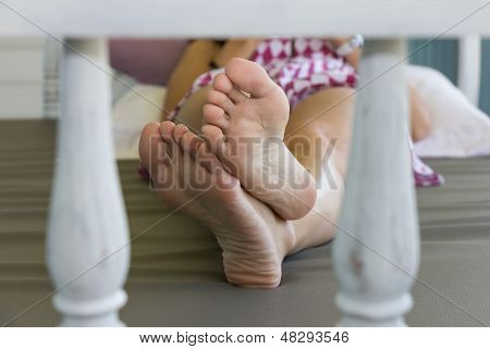 Closeup Feet In Daybed At Balcony