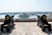 Two cannons in saluting battery on Valletta castle Malta poster