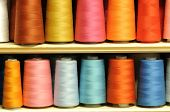 Group of sewing threads in two rows poster