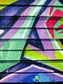 Vibrant color graffiti on wood slatted wall background poster