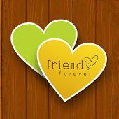Happy friendship day concept with paper sticky in heart shape on wooden background. poster