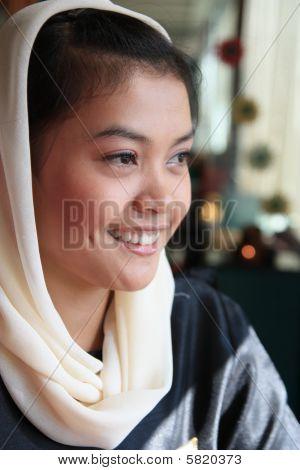 portrait of muslim woman smiling wearing veil poster