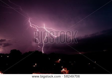 Dark purple lights in Storm a a poster