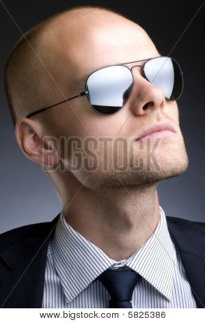 Closeup Picture Of A Businessman With Sunglasses