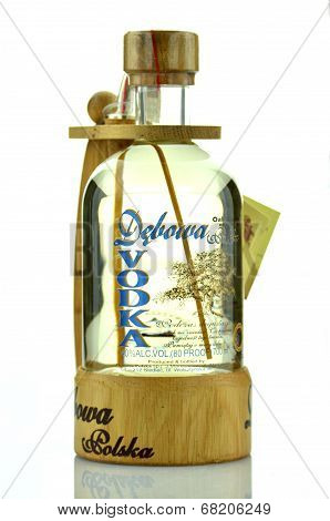 Debowa vodka with wooden handle isolated on white background