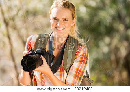 happy young woman hiking in autumn forest