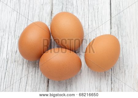 Eggs Stack Isolated On A Wooden Table