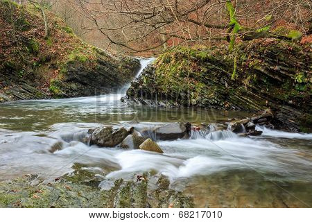 Beautiful Waterfall Comes Out Of A Winding River
