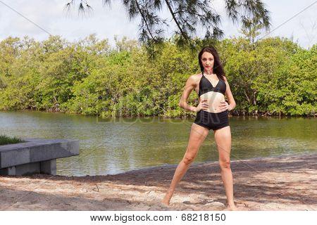 Stock image of a woman in a bikini in nature
