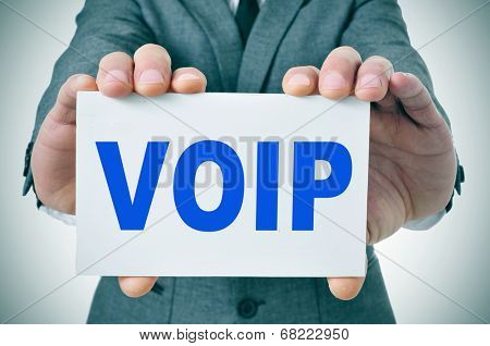man wearing a suit holding a signboard with the text VOIP, Voice Over Internet Protocol, written in it