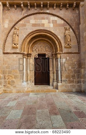 Romanesque style door with the carved tympanum called Puerta del Cordero in the Royal San Isidoro collegiate church from the X century i n Leon Spain poster